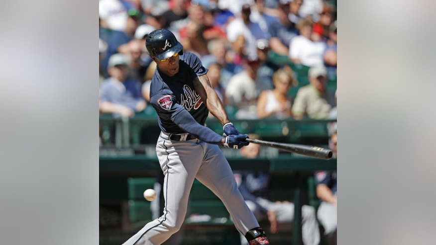 Atlanta Braves' B.J. Upton swings and misses to strike out against the Seattle Mariners in the third inning of a baseball game Wednesday, Aug. 6, 2014, in Seattle. (AP Photo/Elaine Thompson)