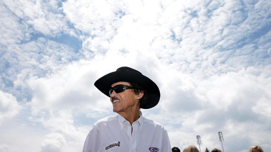 "Former NASCAR great known as ""The King,"" Richard Petty stands at Pocono Raceway, Saturday, Aug. 2, 2014, Long Pond, Pa. (AP Photo/Mel Evans)"