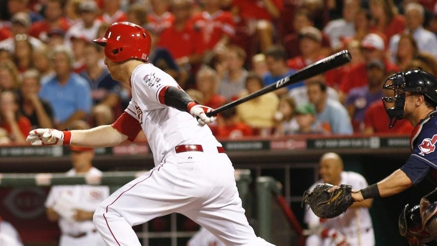 Cincinnati Reds' Todd Frazier hits a two-run double off Cleveland Indians relief pitcher Marc Rzepczynski in the seventh inning of a baseball game, Wednesday, Aug. 6, 2014, in Cincinnati. The Reds won 8-3. (AP Photo/David Kohl)