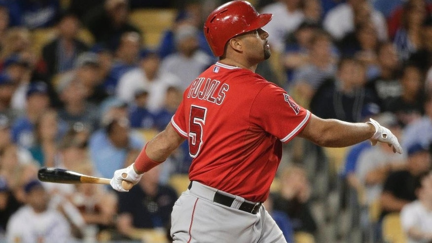 Los Angeles Angels' Albert Pujols watches his home run during the eighth inning of a baseball game against the Los Angeles Dodgers on Tuesday, Aug. 5, 2014, in Los Angeles. (AP Photo/Jae C. Hong)
