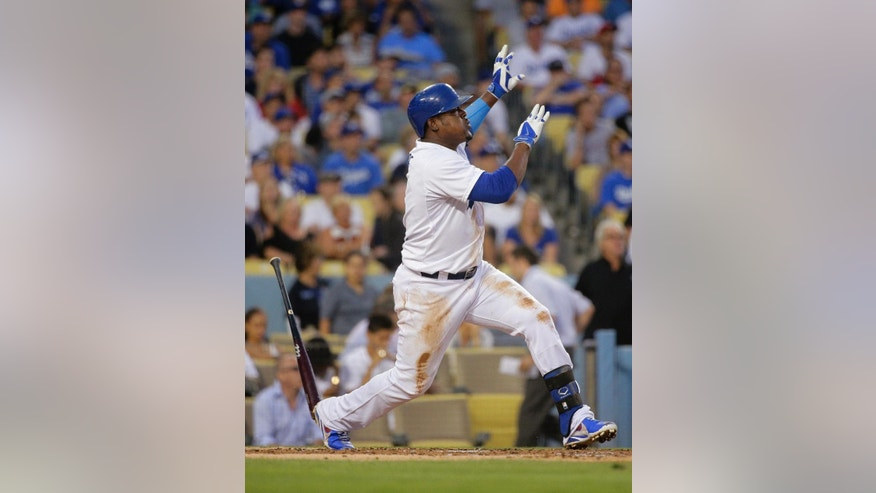 Los Angeles Dodgers' Juan Uribe watches the flight of his three-run home run during the second inning of a baseball game against the Los Angeles Angels on Tuesday, Aug. 5, 2014, in Los Angeles. (AP Photo/Jae C. Hong)