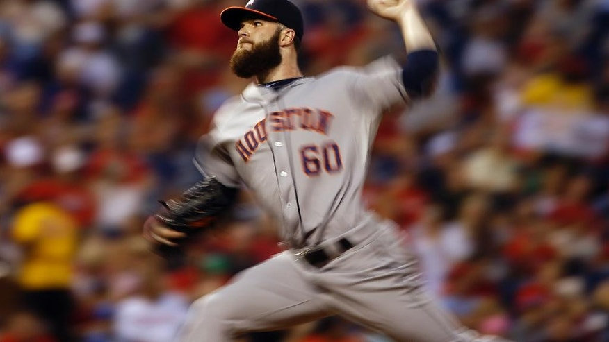 In this image made with a slow shutter speed, Houston Astros' Dallas Keuchel pitches during the fourth inning of an interleague baseball game against the Philadelphia Phillies, Tuesday, Aug. 5, 2014, in Philadelphia. (AP Photo/Matt Slocum)