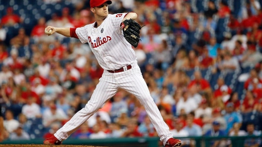 Philadelphia Phillies' Kyle Kendrick pitches during the third inning of an interleague baseball game against the Houston Astros, Tuesday, Aug. 5, 2014, in Philadelphia. (AP Photo/Matt Slocum)