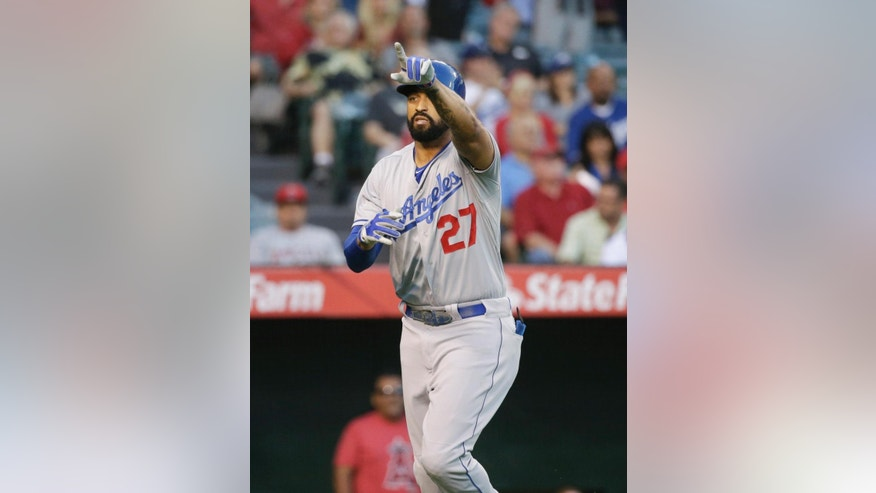 Los Angeles Dodgers' Matt Kemp celebrates his home run during the second inning of a baseball game against the Los Angeles Angels on Wednesday, Aug. 6, 2014, in Anaheim, Calif. (AP Photo/Jae C. Hong)