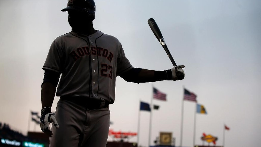 Houston Astros' Chris Carter warms up before batting during the first inning of an interleague baseball game against the Philadelphia Phillies, Thursday, Aug. 7, 2014, in Philadelphia. (AP Photo/Matt Slocum)
