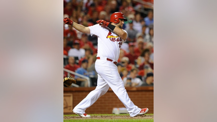 St. Louis Cardinals' Matt Adams follows through on and RBI double against the Boston Red Sox in the first inning in a baseball game, Wednesday, Aug. 6, 2014, at Busch Stadium in St. Louis. (AP Photo/Bill Boyce)