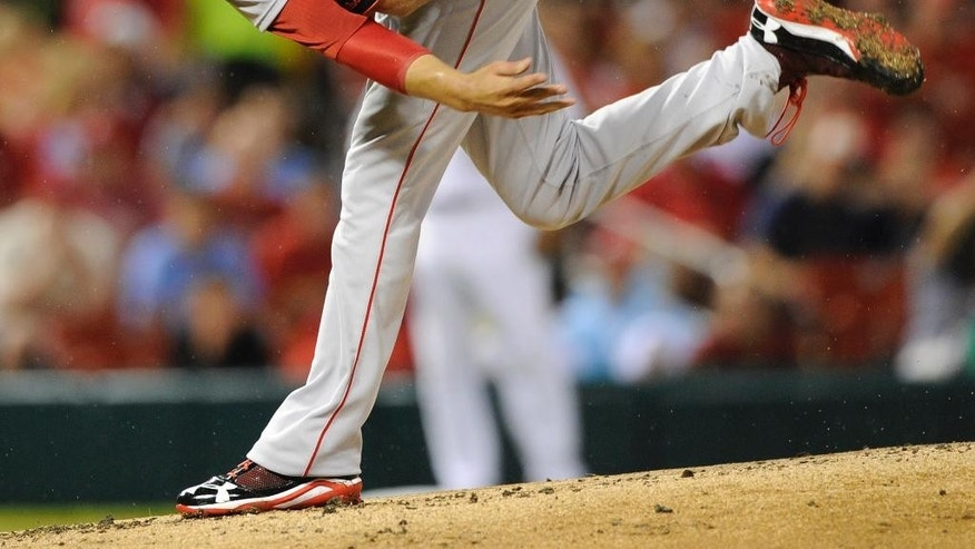 Boston Red Sox's starting pitcher Joe Kelly (56) throws against the St. Louis Cardinals in the first inning in a baseball game, Wednesday, Aug. 6, 2014, at Busch Stadium in St. Louis. (AP Photo/Bill Boyce)
