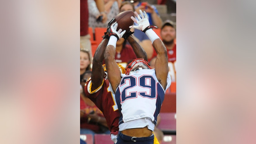 New England Patriots defensive back Malcolm Butler breaks up a pass intended for Washington Redskins wide receiver Aldrick Robinson during the first half of an NFL football preseason game in Landover, Md., Thursday, Aug. 7, 2014. (AP Photo/Richard Lipski)