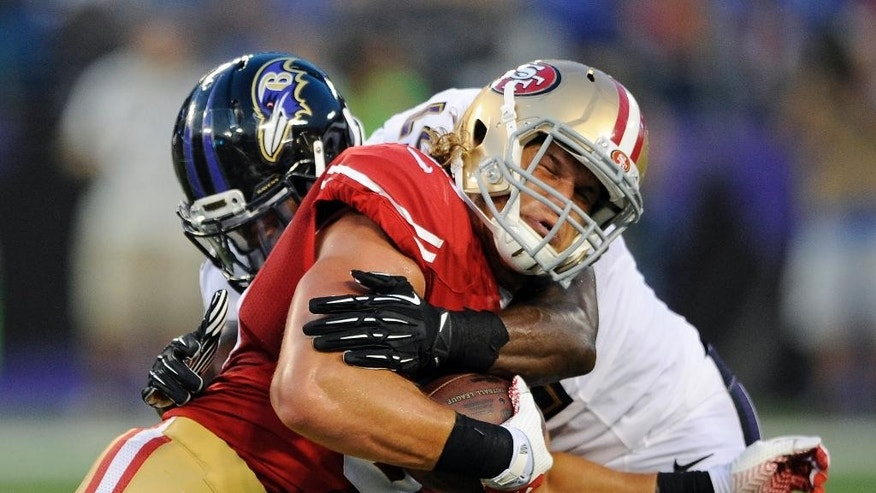 San Francisco 49ers tight end Vance McDonald reacts as he is tackled by Baltimore Ravens inside linebacker C.J. Mosley in the first half of an NFL preseason football game, Thursday, Aug. 7, 2014, in Baltimore. (AP Photo/Nick Wass)
