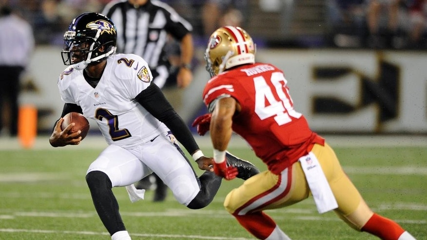 Baltimore Ravens quarterback Tyrod Taylor (2) rushes the ball past San Francisco 49ers cornerback Darryl Morris in the second half of an NFL preseason football game, Thursday, Aug. 7, 2014, in Baltimore. (AP Photo/Nick Wass)