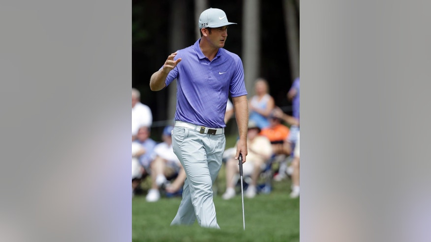 Kevin Chappell reacts to his putt on the 14th hole during the first round of the PGA Championship golf tournament at Valhalla Golf Club on Thursday, Aug. 7, 2014, in Louisville, Ky. (AP Photo/Jeff Roberson)