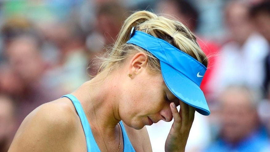 Maria Sharapova, of Russia, reacts during her round of sixteen match against Carla Suarez Navarro, of Spain, at the Rogers Cup tennis tournament Thursday, Aug. 7, 2014 in Montreal. (AP Photo/The Canadian Press, Paul Chiasson)