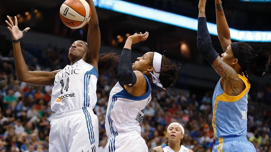 Minnesota Lynx forward Devereaux Peters (14) goes up for a rebound with forward Maya Moore, center, and Chicago Sky forward Tamera Young, right, in the first half of a WNBA basketball game, Thursday, Aug. 7, 2014, in Minneapolis. (AP Photo/Stacy Bengs)