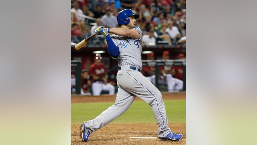 Kansas City Royals' Mike Moustakas connects for a run-scoring single against the Arizona Diamondbacks during the fourth inning of a baseball game on Wednesday, Aug. 6, 2014, in Phoenix. (AP Photo/Ross D. Franklin)