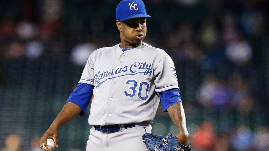 Kansas City Royals' Yordano Ventura exhales before throwing a pitch against the Arizona Diamondbacks during the first inning of a baseball game on Wednesday, Aug. 6, 2014, in Phoenix. (AP Photo/Ross D. Franklin)
