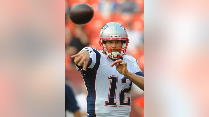 New England Patriots quarterback Tom Brady warms up before an NFL football preseason game against the Washington Redskins in Landover, Md., Thursday, Aug. 7, 2014. (AP Photo/Richard Lipski)