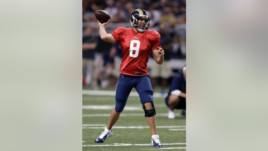 St. Louis Rams quarterback Sam Bradford throws during NFL football training camp at Edward Jones Dome, Saturday, Aug. 2, 2014, in St. Louis. (AP Photo/Jeff Roberson)