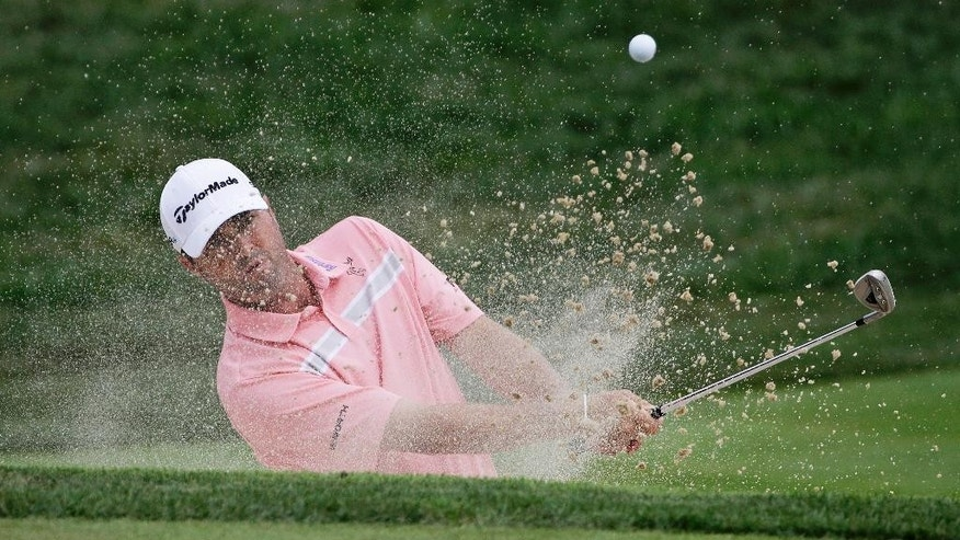 Ryan Palmer hits out of the bunker on the seventh hole during the first round of the PGA Championship golf tournament at Valhalla Golf Club on Thursday, Aug. 7, 2014, in Louisville, Ky. (AP Photo/David J. Phillip)