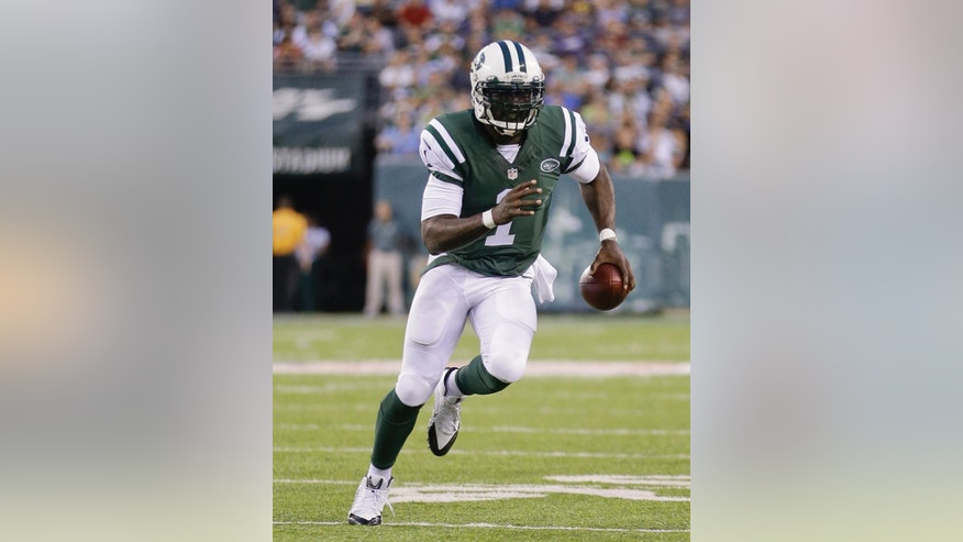 New York Jets quarterback Michael Vick (1) runs the ball against the New York Jets in the second quarter of a preseason NFL football game, Thursday, Aug. 7, 2014, in East Rutherford, N.J. (AP Photo/Frank Franklin II)