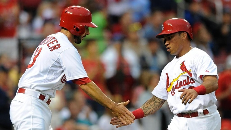 St. Louis Cardinals' Matt Carpenter, left, and Kolten Wong celebrate after scoring on a two-run double by teammate Jhonny Peralta against the Boston Red Sox in the first inning in a baseball game, Thursday, Aug. 7, 2014, at Busch Stadium in St. Louis. (AP Photo/Bill Boyce)