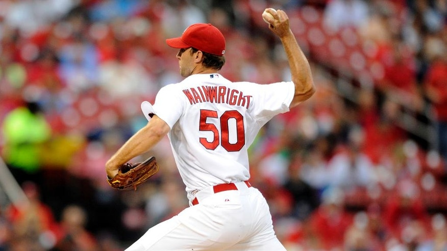 St. Louis Cardinals' starting pitcher Adam Wainwright (50) throws against the Boston Red Sox in the first inning in a baseball game, Thursday, Aug. 7, 2014, at Busch Stadium in St. Louis. (AP Photo/Bill Boyce)