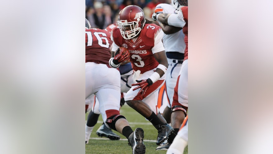 FILE - In this Nov. 2, 2013, file photo, Arkansas running back Alex Collins (3) carries against Auburn during the first half of an NCAA college football game in Fayetteville, Ark. Collins will return for the 2014 season. (AP Photo/Danny Johnston, File)