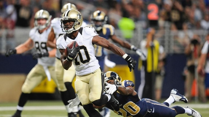 New Orleans Saints wide receiver Brandin Cooks (10) gets past St. Louis Rams cornerback Lamarcus Joyner (20) on a touchdown reception in the third quarter of a preseason NFL football game Friday, Aug. 8, 2014, in St. Louis. (AP Photo/L.G. Patterson)