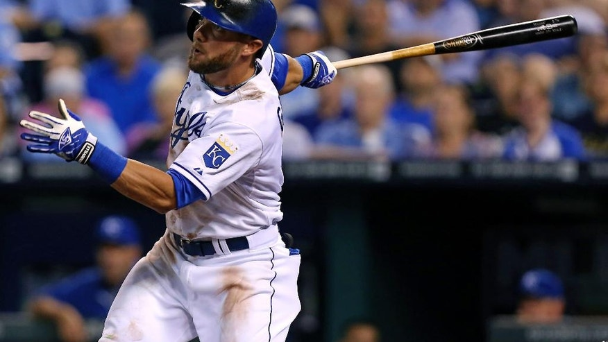 Kansas City Royals' Alex Gordon hits an RBI single in the sixth inning during a baseball game against the San Francisco Giants, Friday, Aug. 8, 2014, in Kansas City, Mo. (AP Photo/Ed Zurga)