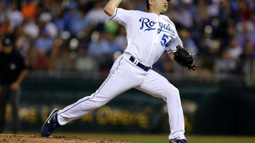 Kansas City Royals relief pitcher Jason Frasor throws in the sixth inning during a baseball game against the San Francisco Giants, Friday, Aug. 8, 2014, in Kansas City, Mo. (AP Photo/Ed Zurga)