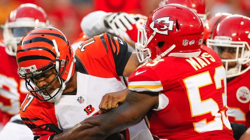 Kansas City Chiefs linebacker Joe Mays, right, sacks Cincinnati Bengals quarterback Jason Campbell (17) in the first half of an NFL preseason football game Thursday, Aug. 7, 2014, in Kansas City, Mo. (AP Photo/Colin E. Braley)