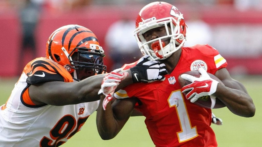 Cincinnati Bengals defensive end Wallace Gilberry (95) tackles Kansas City Chiefs running back De'Anthony Thomas (1) in the first half of an NFL preseason football game Thursday, Aug. 7, 2014, in Kansas City, Mo. (AP Photo/Colin E. Braley)