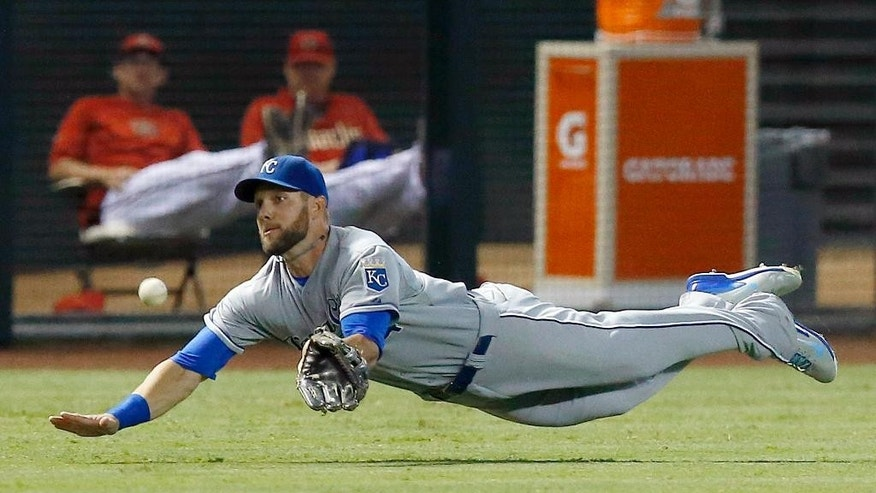 Kansas City Royals' Alex Gordon dives but is unable to catch a line drive hit by Arizona Diamondbacks' Ender Inciarte during the first inning of a baseball game Thursday, Aug. 7, 2014, in Phoenix. Inciarte singled on the play. (AP Photo/Ross D. Franklin)