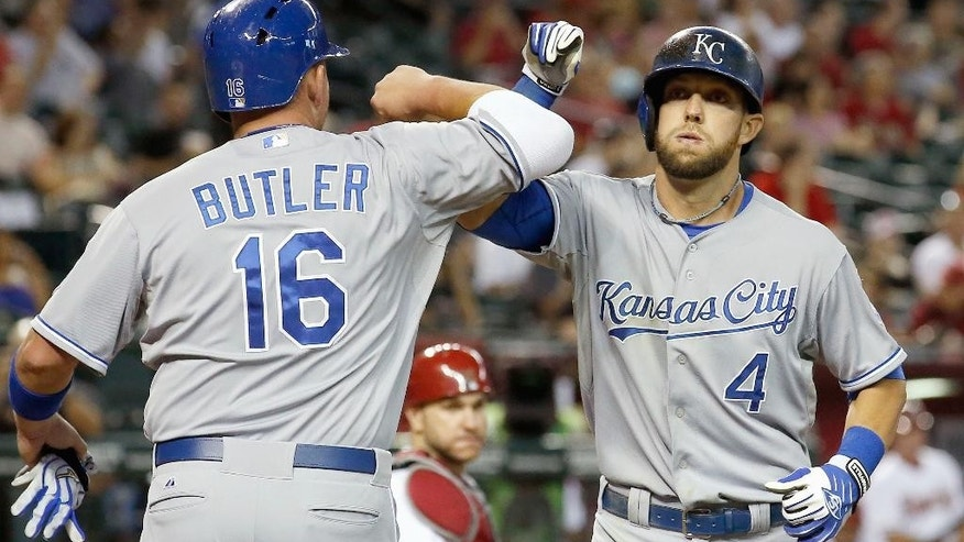 Kansas City Royals' Alex Gordon (4) celebrates his two-run home run against the Arizona Diamondbacks with Billy Butler (16) during the second inning of a baseball game Thursday, Aug. 7, 2014, in Phoenix. (AP Photo/Ross D. Franklin)
