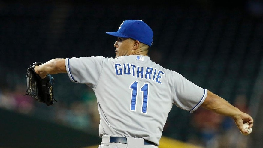 Kansas City Royals' Jeremy Guthrie throws a pitch against the Arizona Diamondbacks during the first inning of a baseball game Thursday, Aug. 7, 2014, in Phoenix. (AP Photo/Ross D. Franklin)