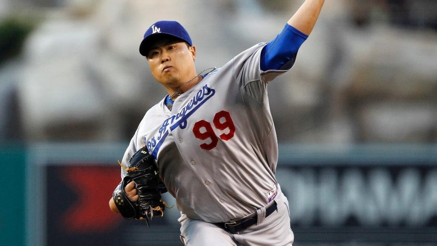 Los Angeles Dodgers starting pitcher Hyun-Jin Ryu, of South Korea, throws against the Los Angeles Angels in the first inning of a baseball game Thursday, Aug. 7, 2014, in Anaheim, Calif. (AP Photo/Alex Gallardo)