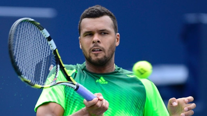 Jo-Wilfried Tsonga, of France, makes a return to Andy Murray, of Great Britain, at the Rogers Cup tennis tournament Friday, Aug. 8, 2014, in Toronto. (AP Photo/The Canadian PressaiFrank Gunn)