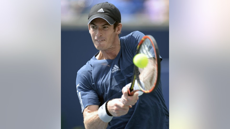 Andy Murray, of Great Britain, returns to Jo-Wilfried Tsonga, of France, at the Rogers Cup tennis tournament, Friday, Aug. 8, 2014 in Toronto. (AP Photo/The Canadian Press, Frank Gunn)