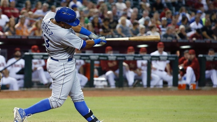 Kansas City Royals' Salvador Perez connects for a two-run single against the Arizona Diamondbacks during the third inning of a baseball game Thursday, Aug. 7, 2014, in Phoenix. (AP Photo/Ross D. Franklin)