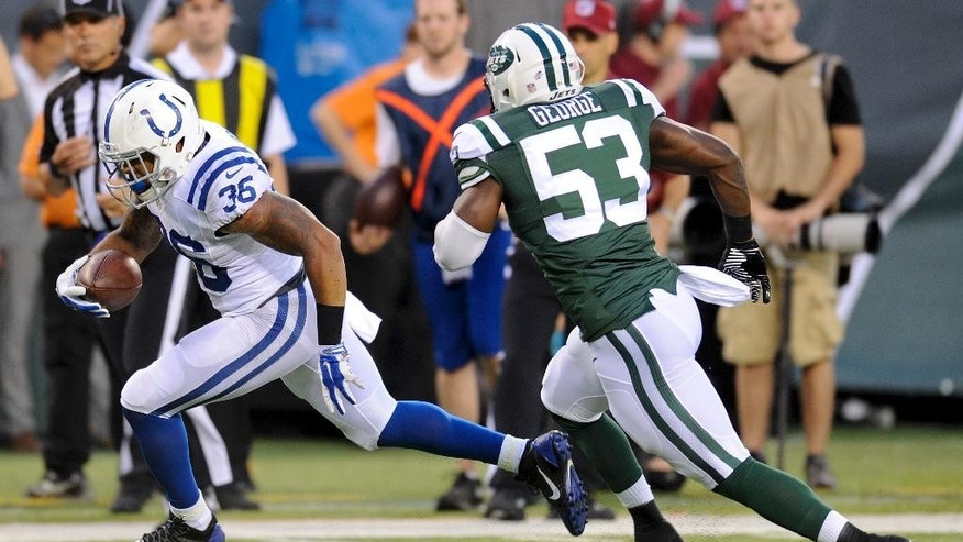 Indianapolis Colts running back Dan Herron (36) runs for a touchdown against New York Jets inside linebacker Jeremiah George (53) after catching a pass from quarterback Matt Hasselbeck in the second quarter of a preseason NFL football game, Thursday, Aug. 7, 2014, in East Rutherford, N.J. (AP Photo/Bill Kostroun)