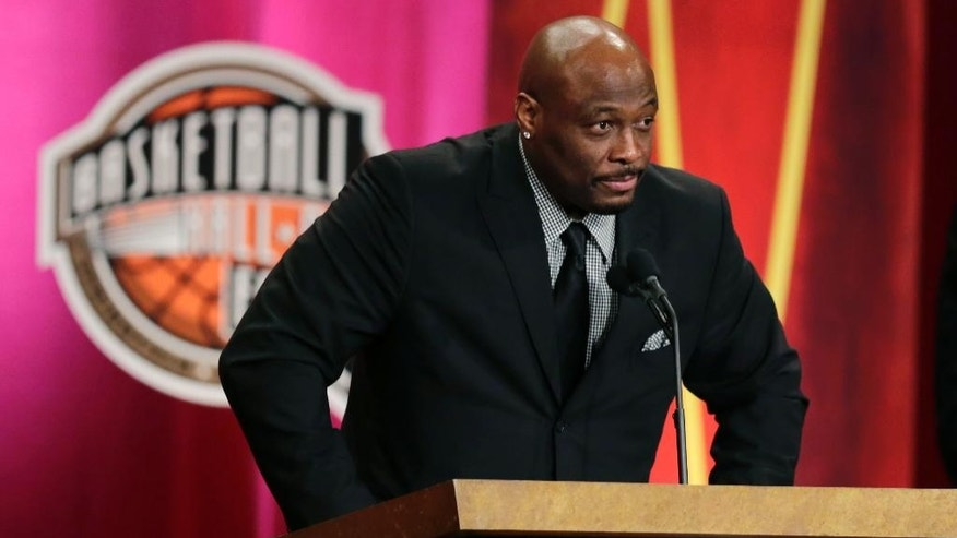 Six-time NBA All-Star Mitch Richmond addresses a gathering during his enshrinement ceremony for the Basketball Hall of Fame in Springfield, Mass., Friday, Aug. 8, 2014.  Richmond won the 2002 NBA Chamionship with the Los Angeles Lakers. (AP Photo/Charles Krupa)