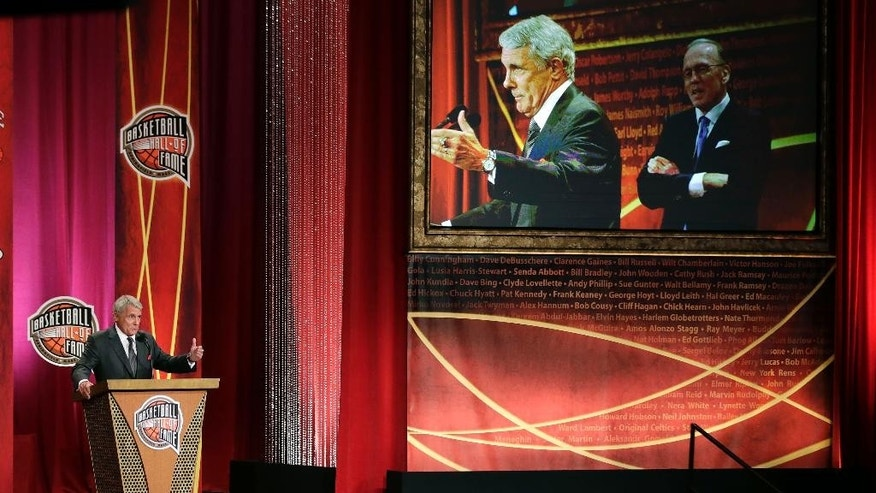 Former University of Maryland head coach Gary Williams gestures as he addresses a gathering during his enshrinement ceremony for the Basketball Hall of Fame in Springfield, Mass., Friday, Aug. 8, 2014. Williams led Maryland to 11 consecutive NCAA Tournament appearances from 1994 to 2004. (AP Photo/Charles Krupa)