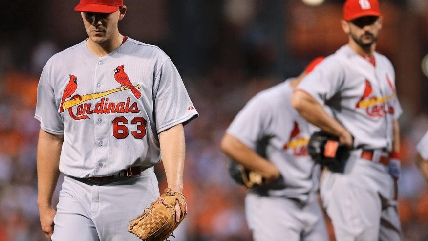 St. Louis Cardinals starting pitcher Justin Masterson, left, walks off the field after being relieved in the third inning of an interleague baseball game against the Baltimore Orioles, Friday, Aug. 8, 2014, in Baltimore. (AP Photo/Patrick Semansky)