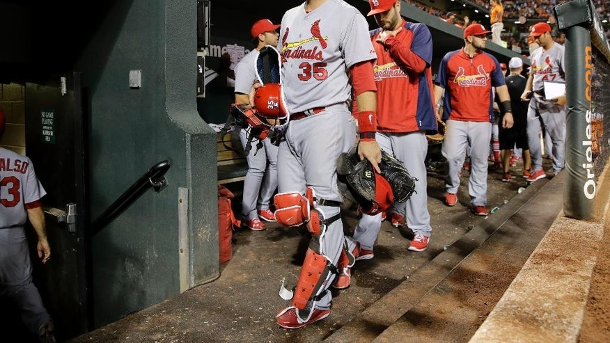 St. Louis Cardinals catcher A.J. Pierzynski, center, heads to the clubhouse after an interleague baseball game against the Baltimore Orioles, Friday, Aug. 8, 2014, in Baltimore. Baltimore won 12-2. (AP Photo/Patrick Semansky)