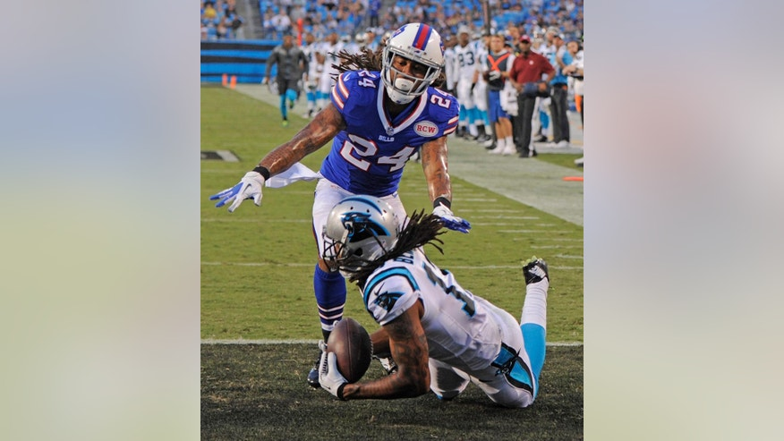 Carolina Panthers' Kelvin Benjamin, front, catches a touchdown pass as Buffalo Bills' Stephon Gilmore, back, defends during the first half of a preseason NFL football game in Charlotte, N.C., Friday, Aug. 8, 2014. (AP Photo/Mike McCarn)