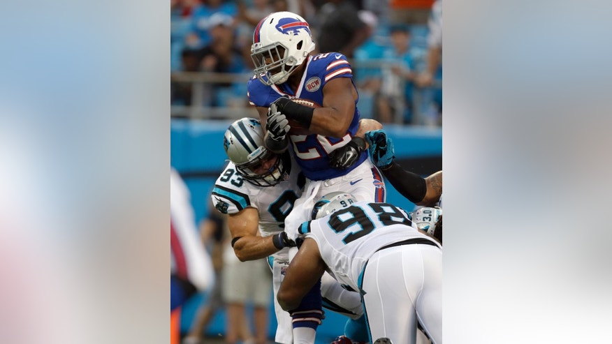 Buffalo Bills' Fred Jackson (22) is stopped on fourth down by Carolina Panthers' Star Lotulelei (98) and Chase Blackburn (93) during the first half of a preseason NFL football game in Charlotte, N.C., Friday, Aug. 8, 2014. (AP Photo/Bob Leverone)