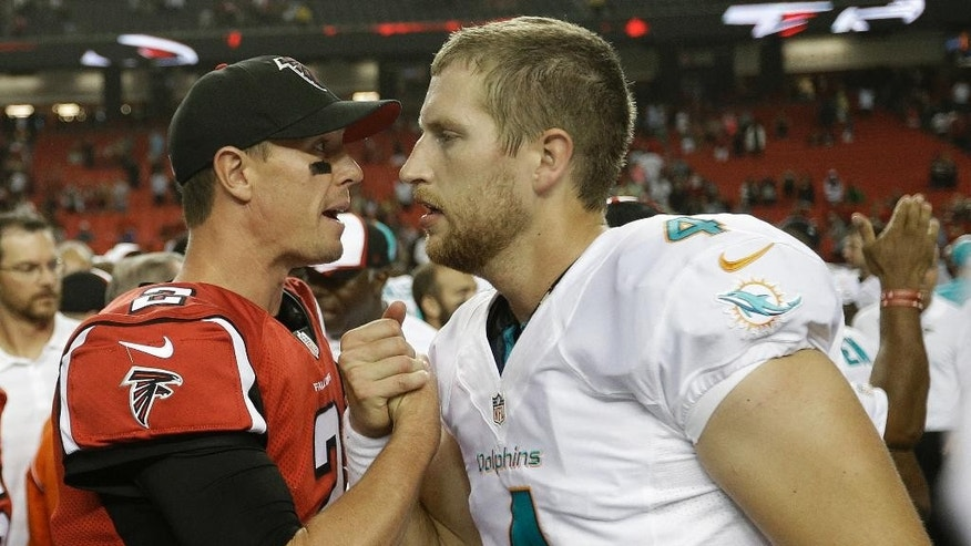 Atlanta Falcons quarterback Matt Ryan (2) shakes hands with Miami Dolphins quarterback Seth Lobato (4) after the second half of an NFL preseason football game, Friday, Aug. 8, 2014, in Atlanta. The Atlanta Falcons won 16-10.  (AP Photo/David Goldman)
