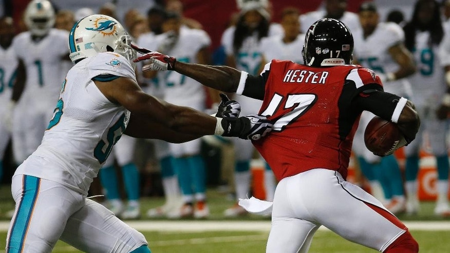 Atlanta Falcons wide receiver Devin Hester (17) moves away from Miami Dolphins linebacker Jonathan Freeny (56) during the first half of an NFL preseason football game, Friday, Aug. 8, 2014, in Atlanta.  (AP Photo/John Bazemore)