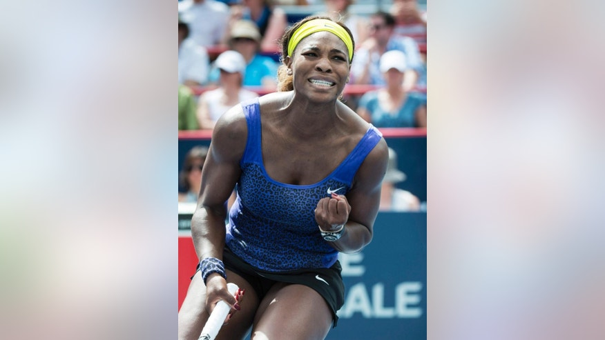 Serena Williams celebrates a point against Caroline Wozniacki, from Denmark, at the Rogers Cup tennis tournament Friday, Aug. 8, 2014,  in Montreal. Williams defeated Wozniacki 4-6, 7-5, 7-5. (AP Photo/The Canadian Press, Paul Chiasson)