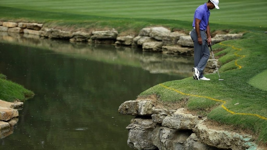 Tiger Woods stands on the edge of the 15th green during the first round of the PGA Championship golf tournament at Valhalla Golf Club on Thursday, Aug. 7, 2014, in Louisville, Ky. (AP Photo/Jeff Roberson)