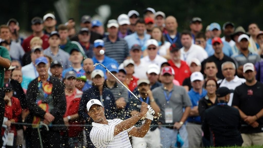 Tiger Woods hits out of the bunker on the first hole during the second round of the PGA Championship golf tournament at Valhalla Golf Club on Friday, Aug. 8, 2014, in Louisville, Ky. (AP Photo/Jeff Roberson)